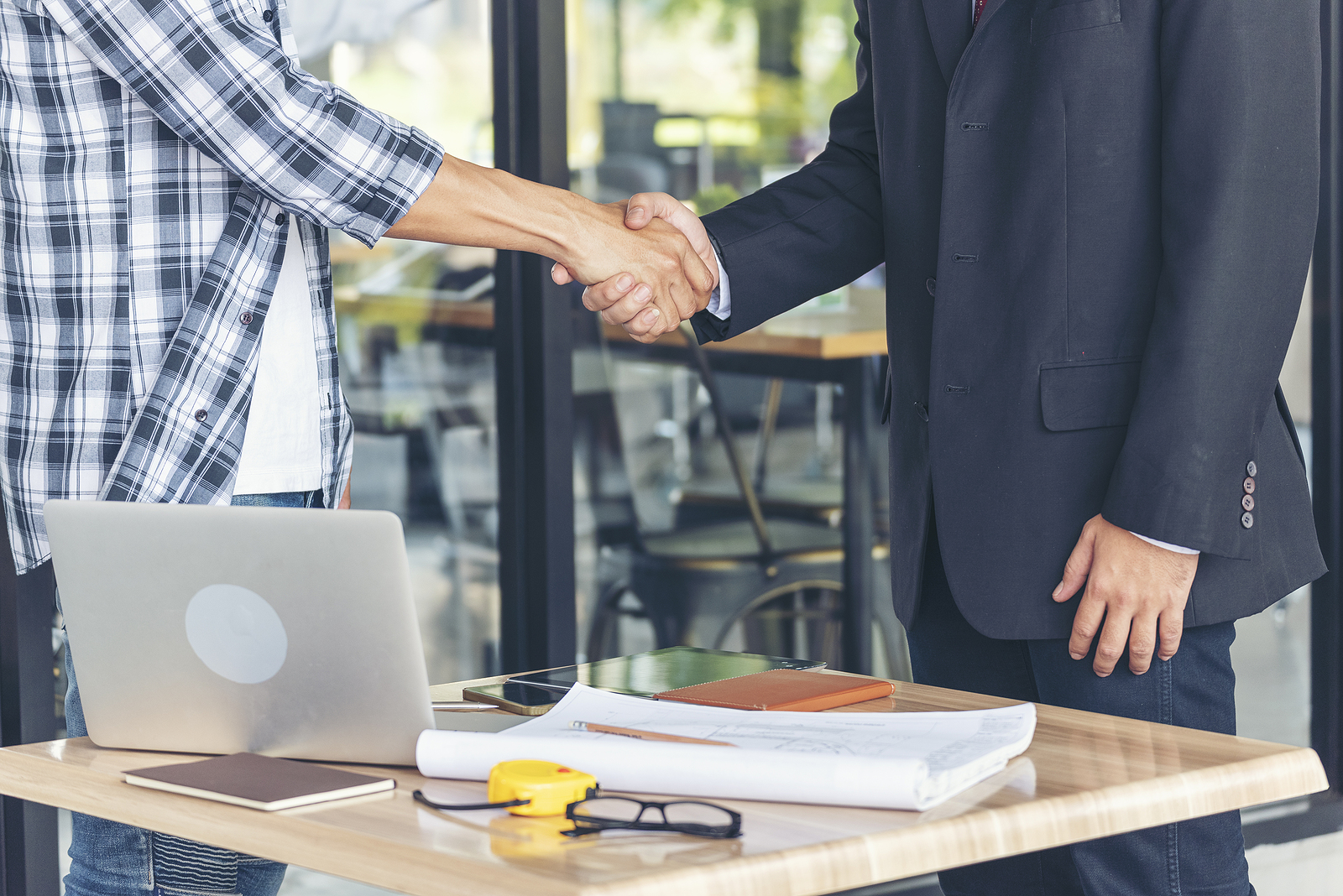 Employer & Candidate Shaking Hands After Agreeing to Contract Jobs