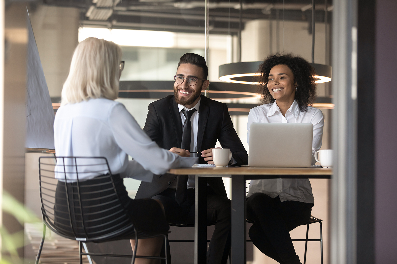 Hiring Manager interviews job candidate for IT role.